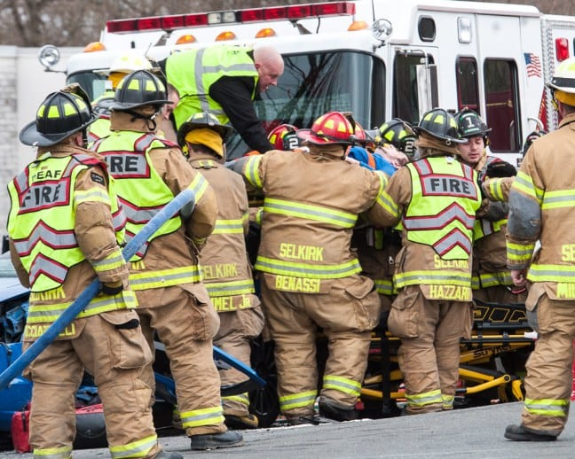 Selkirk firefighters lift Russell Schwimmer out of his Ford Focus on Tuesday, April 17. (Jim Franco/Spotlight News)