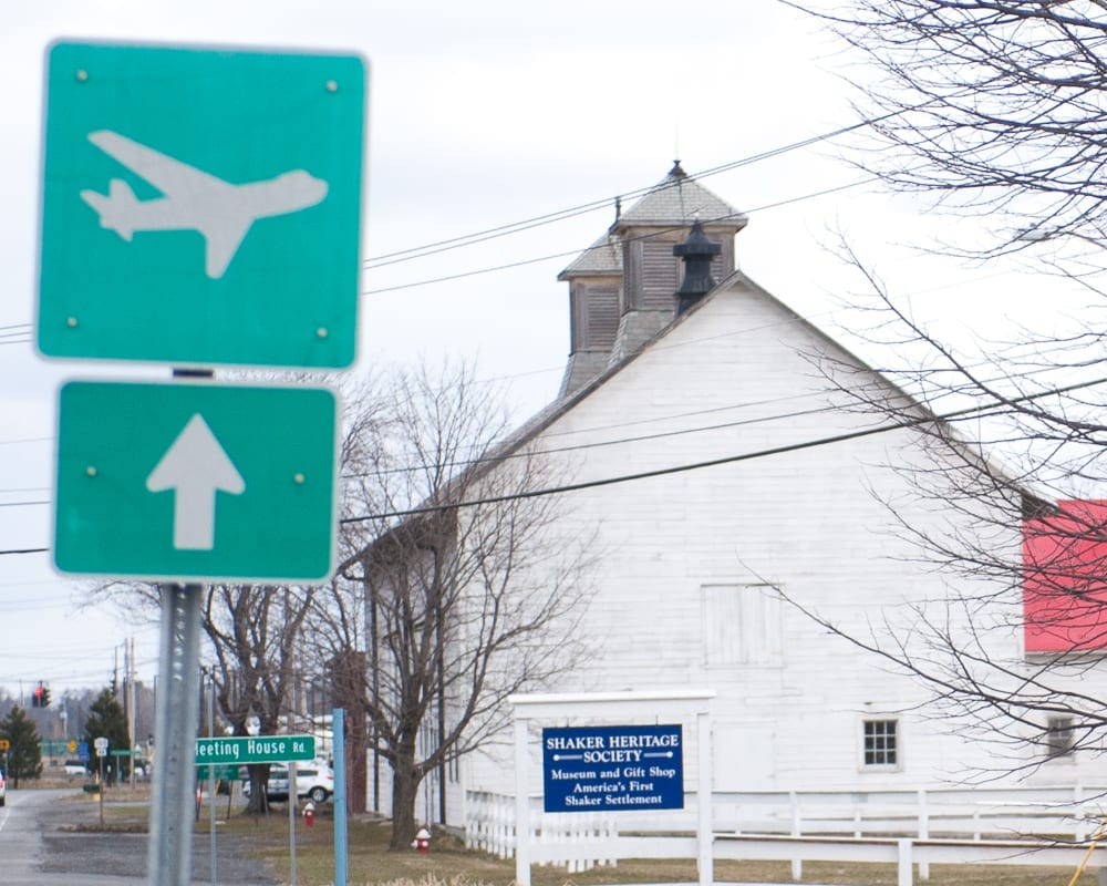 The entrance to the Shaker Historical Society with a sign pointing to the nearby airport. (Photo by Jim Franco/Spotlight News)