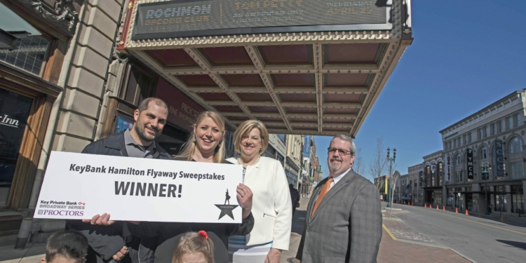 KeyBank Hamilyton Flyaway Sweepstakes winner Nicole Consiglio, center, of Voorheeseville with her husband Steve and their children Olivia and Vinnie pose with Fran O'Rourke, market leader, Capital Region, Key Private Bank and Dan Hanifin, relationships director at Proctors Monday, April 23, 2018. Nicole is the winner of an all expenses paid trip to Chicago to see Hamilton.