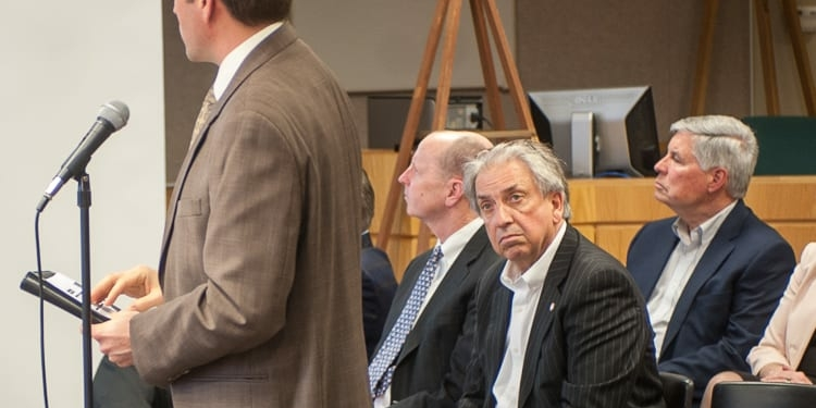 Galesi President and CEO David Buicko listens to a presentation of the economic impacts a plan to develop the old Starlite theater site would have on the community. (Jim Franco/Spotlight News)