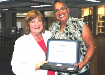 Charmaine Wijeyesinghe, right, is pictured along with receiving a certificate from Lynne Lenhardt. Lenhardt also decided against seeking re-election onto the school board after 20 years of service. Photo courtesy of BCSD