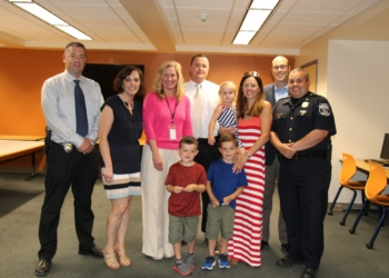 Det. Chad Rice, back and center, and family stands with members of the Bethlehem Central School District and Bethlehem Police Department.  Rice served as the school district's resource officer for mor than a decade. Photo submitted