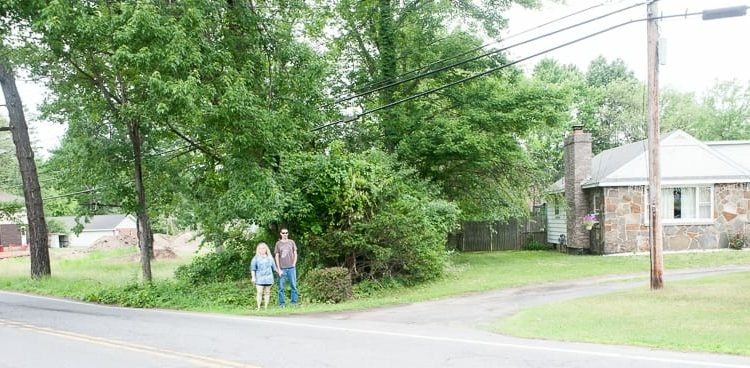 The Leones stand between their home on Vly Road and a plot of land where two apartment buildings are proposed. Jim Franco/Spotlight News