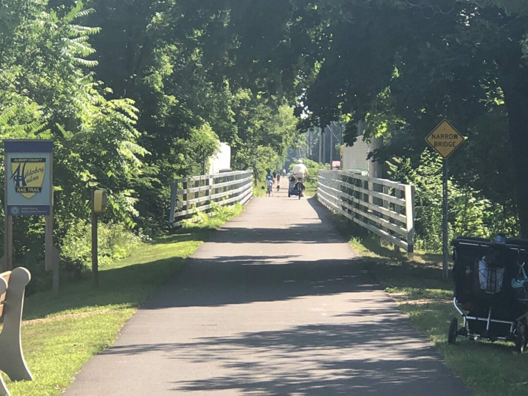 People bike and walk along the Albany County Helderberg Hudson Rail Trail, crossing from Elsmere to Delmar. Photos by Ali Hibbs / Spotlight News