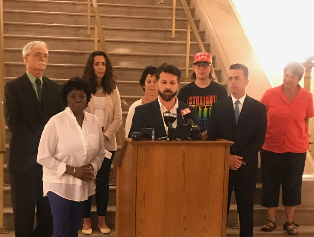 """Backed by advocates and fellow legislators, Bryan Clenahan speaks in advance of the vote on the """"conversion therapy"""" ban. Photo by Amanda Savarese, Albany County"""
