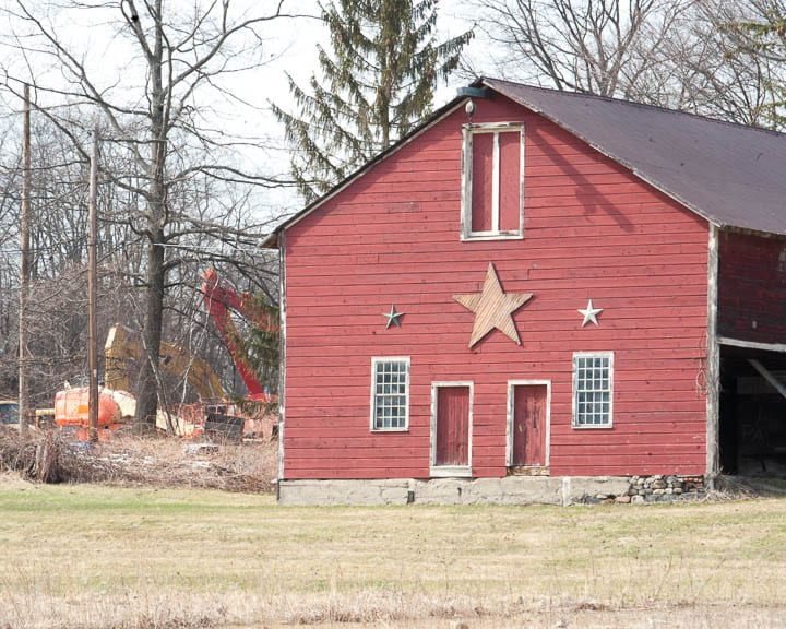 A barn dating back to the Shakers and construction equipment in the background. Jim Franco / Spotlight News