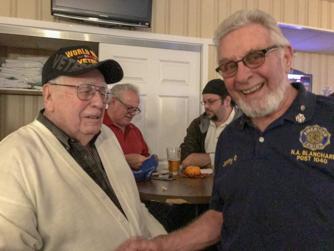 John Osterhout, chairman of the Sons of the American Legion in Elsmere (above, right) enjoys a few laughs with Al Hofaker (above, left), a veteran of World War II, during an appreciation dinner at Blanchard Post on Saturday, Nov. 3.  Michael Hallisey /  Spotlight News