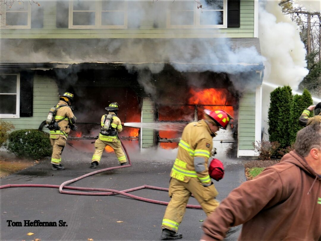 Firefighters attempt to control the fire in the house's garage area. Tom Heffernan Sr. / Spotlight News