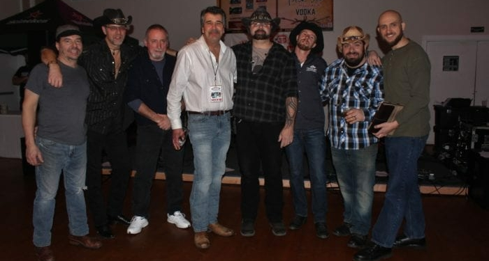 True Grit Outlaws, with their sound man, Matt (far right) and 88.3 The Saint Radio Personality, Vito Ciccarelli, at Parti Events & Banquet Hall, Troy, NY 1/10/19. Photo Credit: Amy Modesti