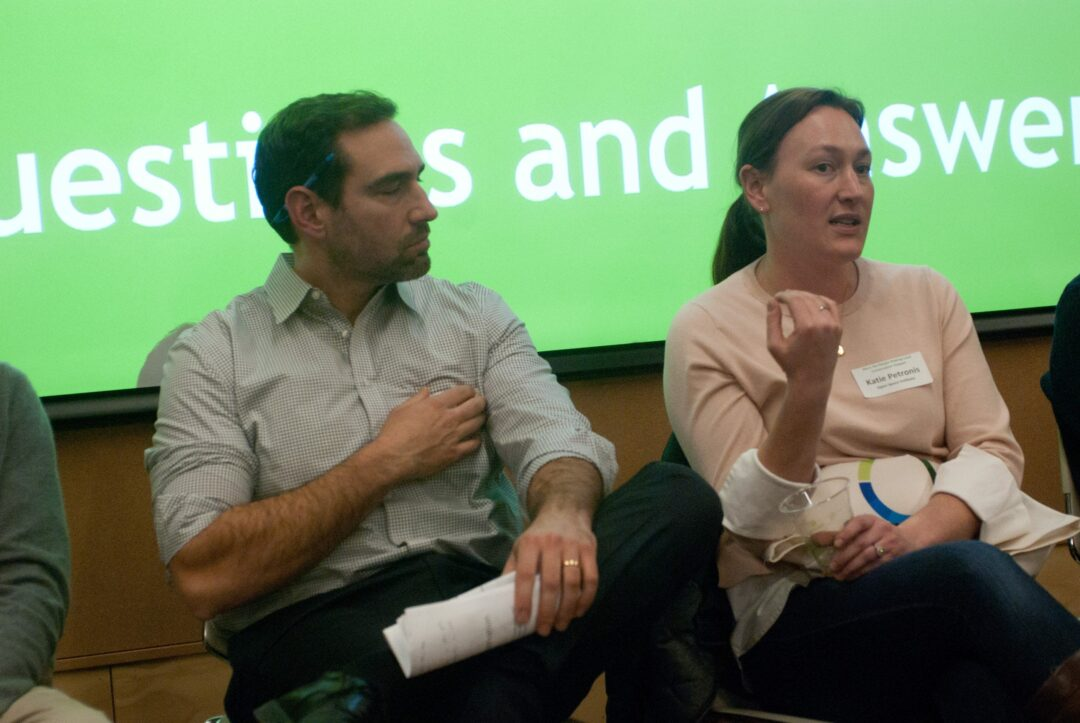 Albany County Land Bank executive director Adam Zaranko, left, listens as Open Space Institute's northern program director Katie Petronis, right, answers an audience question about what benefits come with land conservation. Diego Cagara / Spotlight News