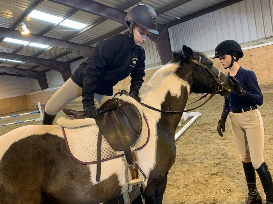 Members of the Upstate Equestrian Team practice with coach Elissa Therrien's horses for the upcoming March 16-17 Interscholastic Equestrian Association Zone 2 Championships. Diego Cagara / Spotlight News