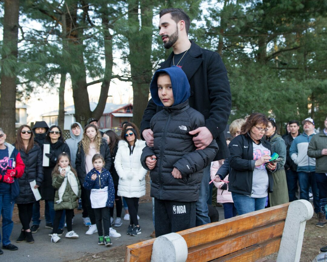 Michael and Nino DiNovo thank the crowd while standing on a bench dedicated to their brother Niko. (Jim Franco / Spotlight News)