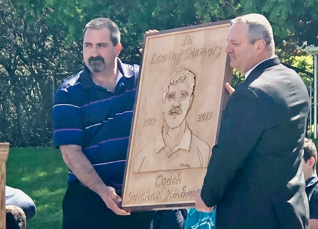 Brian Jerard and South Colonie Athletic Director Joseph Guardino present Coach A's plaque to the public. Photo provided by the South Colonie School District.
