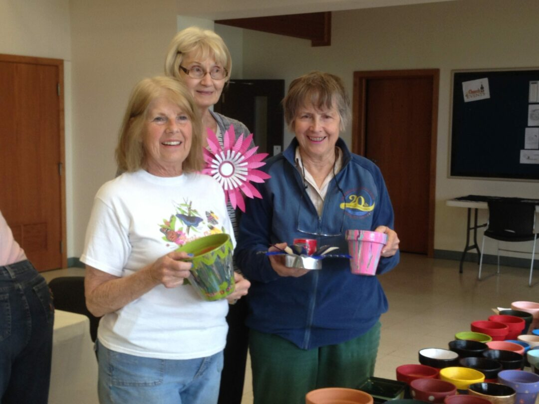 L-R: Master Gardener Martie Teumim, member Peggy Mull and Bethlehem Garden Club president Dodie Seagle assist to painting flower pots for the Botanical Boutique, a new feature from the Bethlehem Garden Club which will happen on Wednesday, June 12, the same day as the Annual Garden Tour. Source: Beverly Goodfellow / Bethlehem Garden Club
