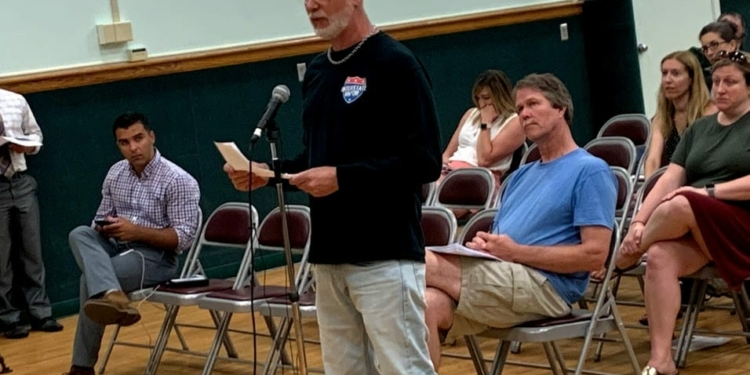 Interstate Vapor owner Leo Carusone, above, speaks against the proposed moratorium prior to the Town Board's vote. He opened his business in 2015 and said he always ran it responsibly. Diego Cagara / Spotlight News