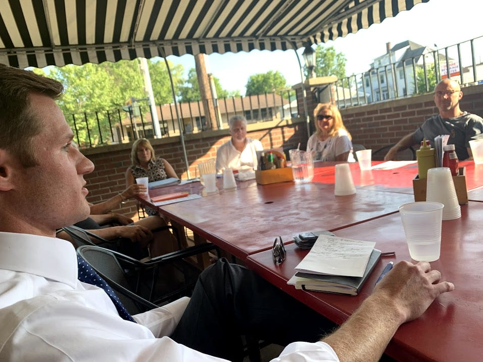 Town Board member Jim Foster, left,listens as Delaware Avenue business owners voiced their concerns. Diego Cagara / Spotlight News