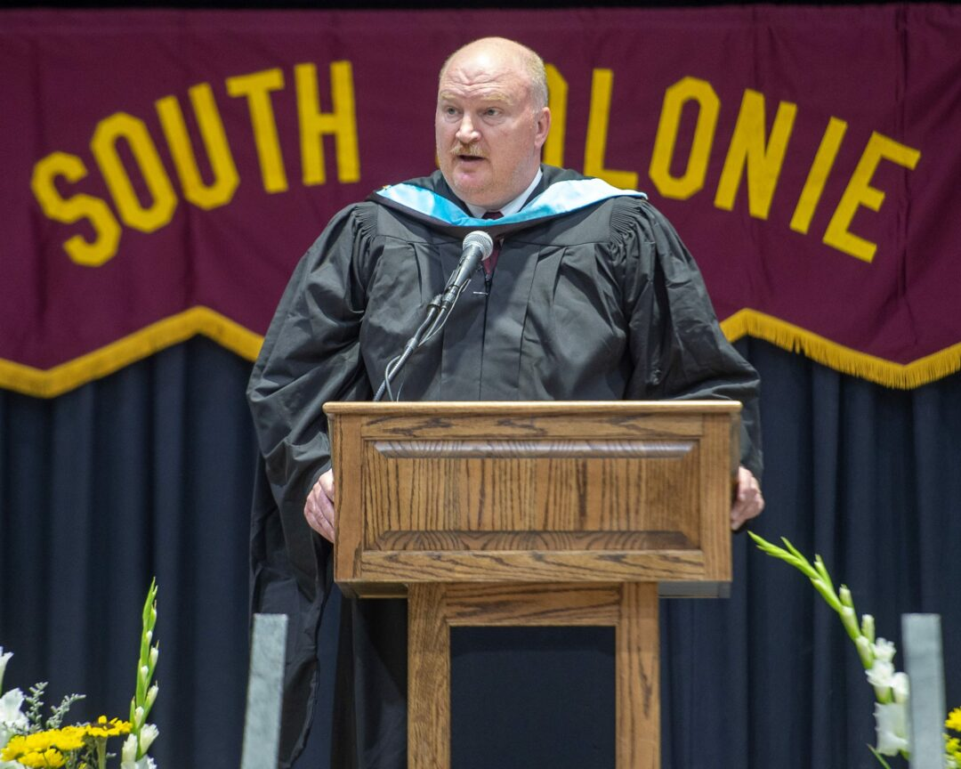 Superintendent Jonathan Buhner speaks at the Colonie High graduation in June. Jim Franco/Spotlight News