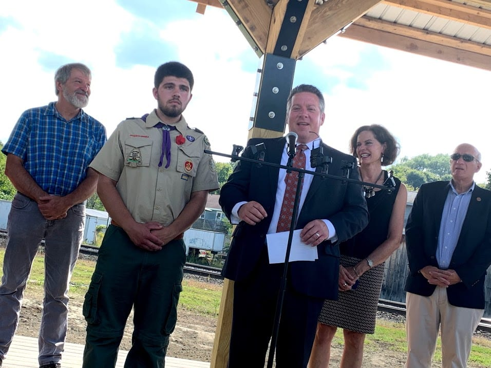 Voorheesville Troop 73 boy scout Michael Strauss, center left, listens as Albany County Executive Daniel P. McCoy, center right, praises his dedication to develop a train-viewing platform for the community and traveling train enthusiasts.Diego Cagara / Spotlight News