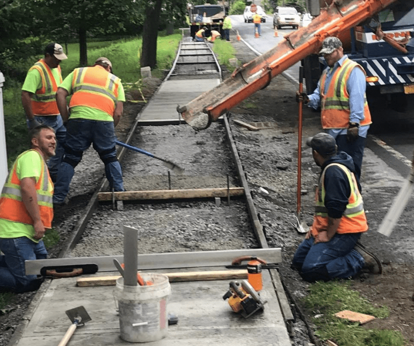 The town's Highway Department workers busy pouring a sidewalk.Submitted photo