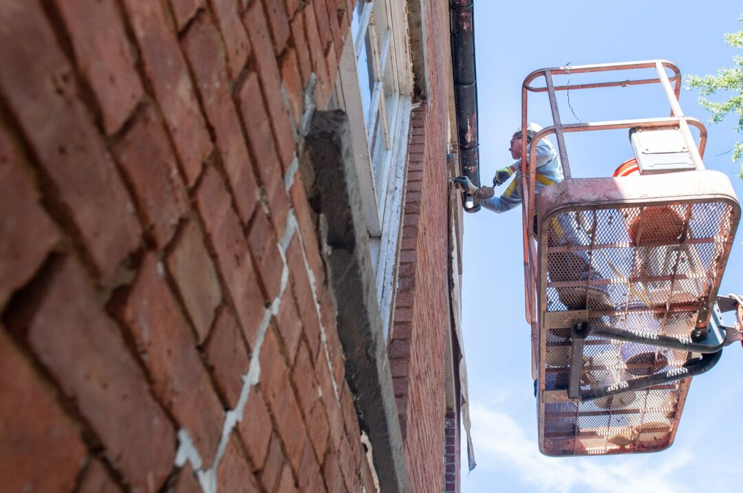 Ken Granger, of VMJR Companies, points up brick on the outside of the Pruyn House. Jim Franco/Spotlight News