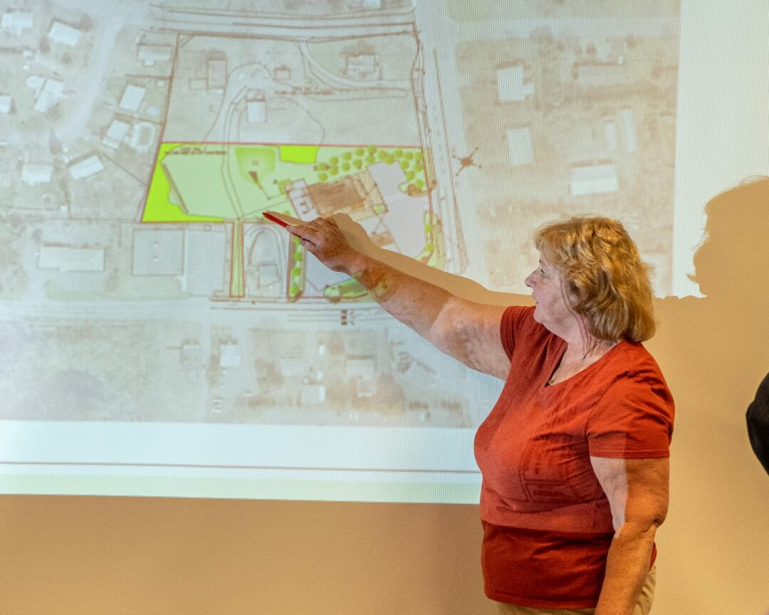 Paula Catellier, a resident of Castle Court, speaks to the Planning Board about the project to build a bigger Stewart's in her neighborhood.  Jim Franco / Spotlight News