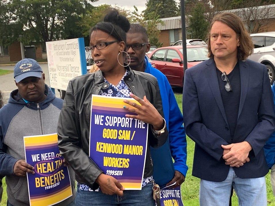 Good Samaritan employee Teneisha Addison, center, gets emotional about possibly losing health benefits and her job. Diego Cagara / Spotlight News