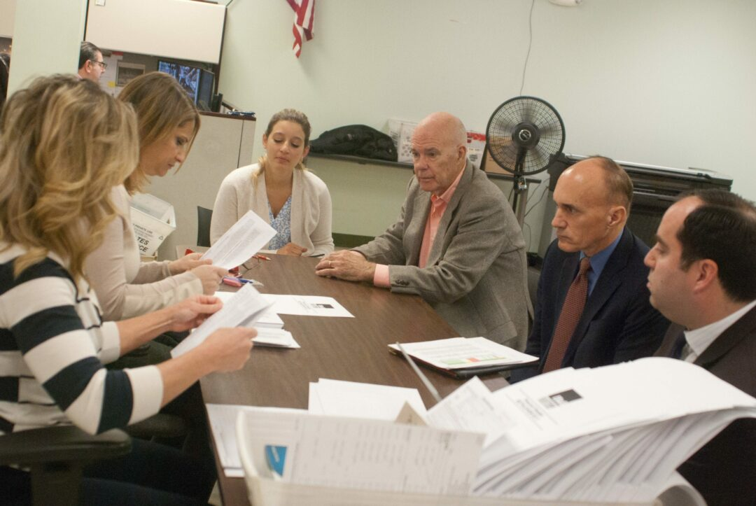 The absentee ballots being reviewed and counted at the Albany County Board of Elections. Diego Cagara / Spotlight News