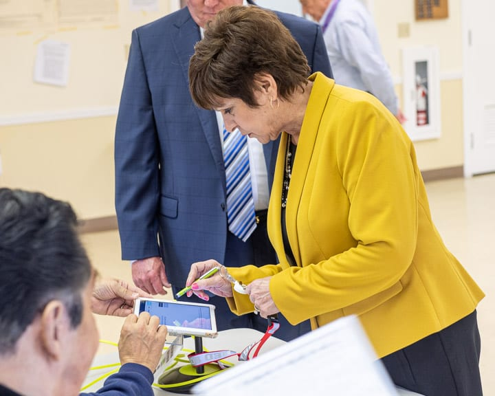 Supervisor Paula Mahan casts her vote at the Latham Community Baptist Church on Forts Ferry Road on Tuesday, Nov. 5 (Jim Franco / Spotlight News)
