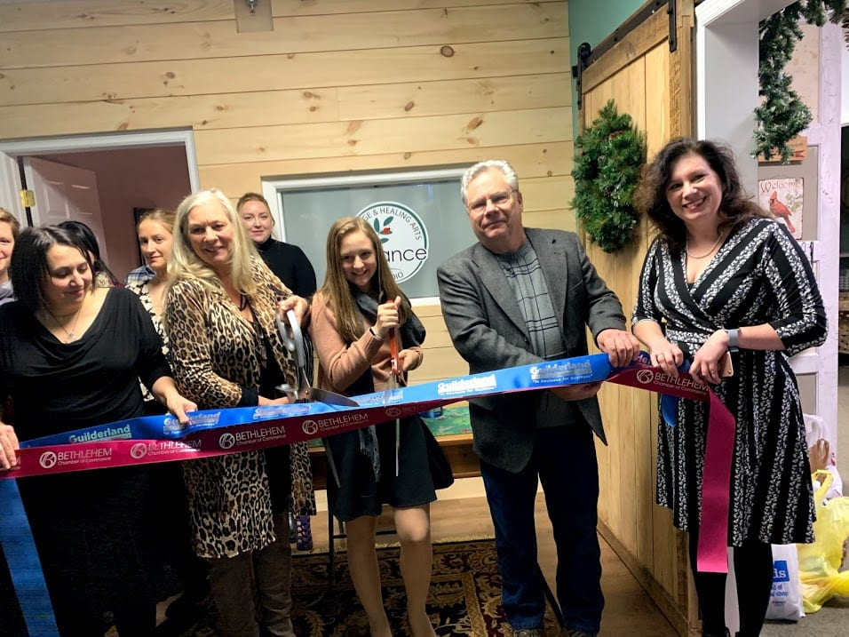 Balance Massage and Healing Arts owner Denise Healy Mason, fourth from left, credited her fellow longtime colleagues and loyal patrons for helping the studio stay open for the last 18 years.Diego Cagara / Spotlight News