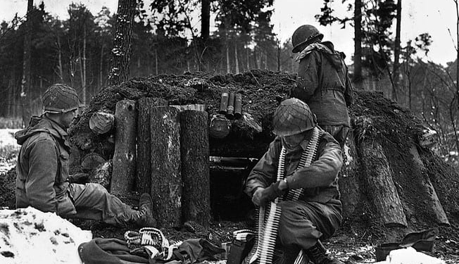 U.S. Army Soldiers of the 42nd Infantry Division's Task Force Linden prepare a defensive position at their log and dirt bunker near Kauffenheim, France, Jan. 8, 1945.2. (U.S. Army Photo)