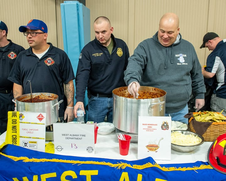 Members of the West Albany Fire Department serves up its Judge's Choice wining chili at the Village of Colonie Recreation Center.      Jim Franco/Spotlight News