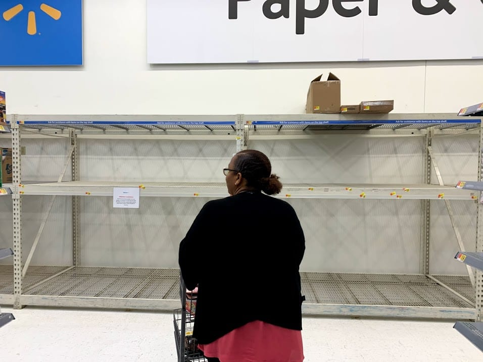 A woman finds empty shelves when looking for toilet paper at the Glenmont Walmart store. The Capital District has seen four positive cases of the novel coronavirus as of Friday, March 13, prompting numerous residents to begin shopping for supplies. Diego Cagara / Spotlight News