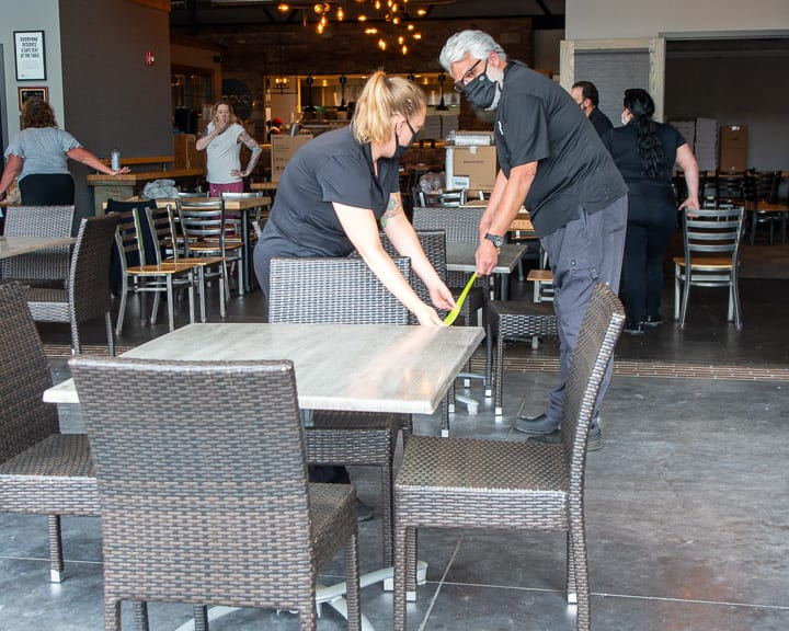 John LaPosta, owner of Innovo Kitchen in Latham, makes sure his tables are six feet apart in response to Gov. Andrew Cuomo allowing restaurants to offer outdoor dining while maintaining 6 feet of social distance (Jim Franco/Spotlight News)