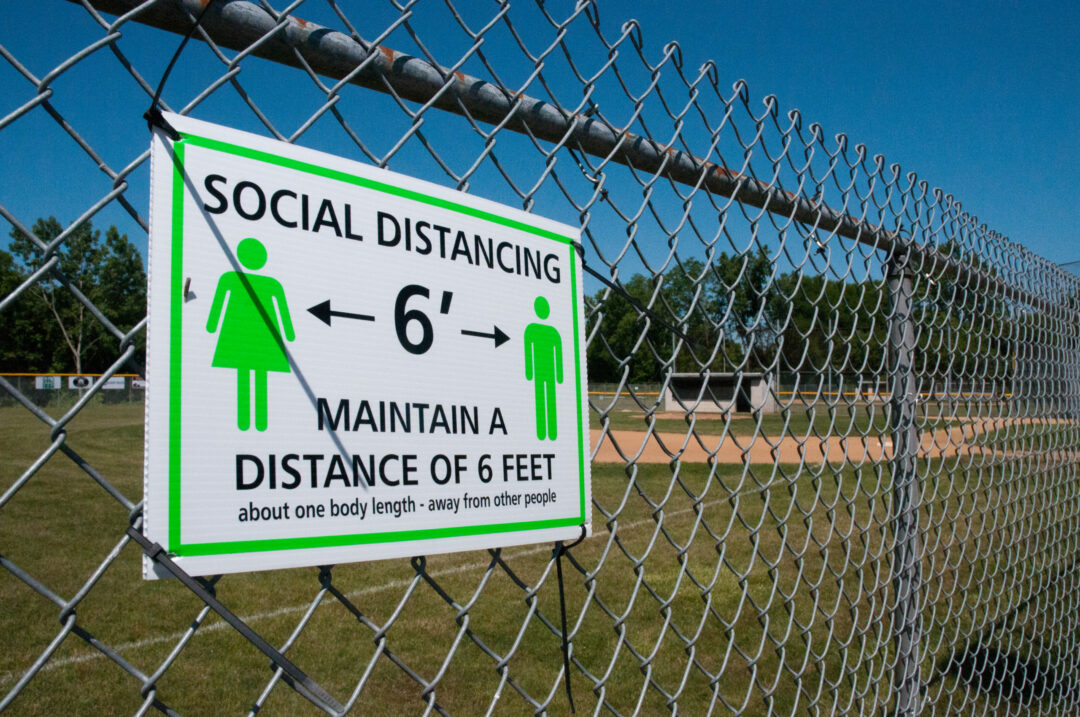 Magee Park has new signage and ground markers to remind spectators to practice safe social distancing while watching their kids play ball this summer.  Michael Hallisey / Spotlight News