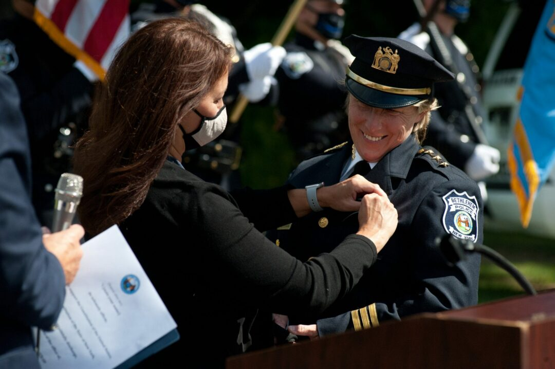 Gina Cocchiara is all smiles during her pinning ceremony on Monday, Aug. 31. She was named the town's newest police chief. Michael Hallisey / Spotlight News