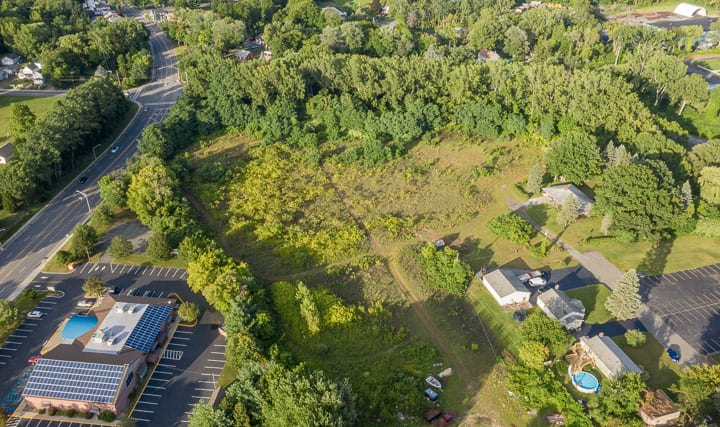 The chunk of land off Everett Road where the senior housing project will be constructed with the Zaloga post in the lower left corner (Jim Franco/Spotlight News)