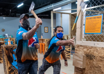 Gary Dayter and Mark Mirasol toss axes at the Lazy Axe on Central Avenue in Colonie  Jim Franco/Spotlight News