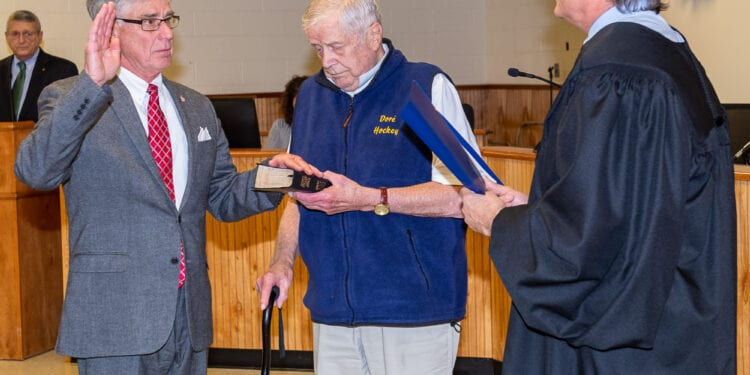 Fred Field holds the Bible as his son, Rick Field, is administered the Oath of Office to serve on the Colonie Town Board by Judge Peter Crummey in January, 2020. (Jim Franco / Spotlight News)