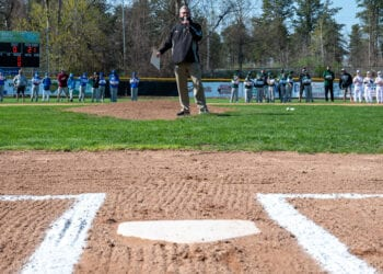 Colonie Little League President Rodger Wyland MCs the Opening Day ceremony. (Jim Franco/Spotlight News)