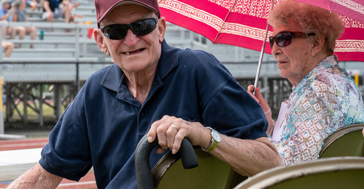 Harry Koch and his wife at the track meet that now bears his name on Saturday, May May 22 (Jim Franco/Spotlight News)