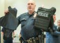 Colonie police chief Jonathan Teale holds up a piece of body armor in 2017 (Jim Franco/Spotlight.com)