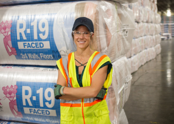 Casey Griner (Crowley) stands in front of rolls of Owens Corning's pink home insulation inside her 220-acre plant in Selkirk.Photo: John McIntyre / Spotlight News