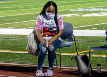 Tareen Lynch-Greene,  Destiny Greene's mom, holds a candle during a vigil on the North Colonie campus. (Jim Franco/Spotlight News)
