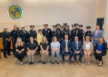Supervisor Paula Mahan, members of the Town Board, Police chief Jonathan Teale and EMS Chief Chris Kostyun pose for a group photo with the new hires and those recently promoted.   Jim Franco / Spotlight News