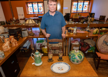 Robert Meringolo, of the Appraisers Road Show, stands next to items in the estate of Hans Toch.   Jim Franco / Spotlight News