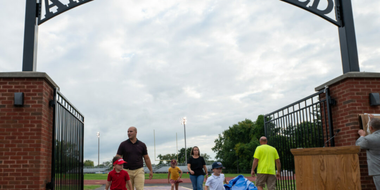 The children and grandchildren of longtime Colonie teacher and coach Mike Ambrosio after unveiling the new name of the Colonie High football field. (Jim Franco / Spotlight News.com)