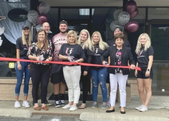 The ribbon cutting at Ultimate Nutrition. Kellie Acker is front and center  Photo provided